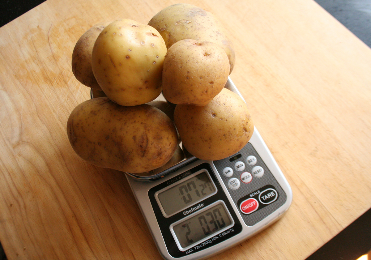 Weighing potatoes to get 2 lbs.