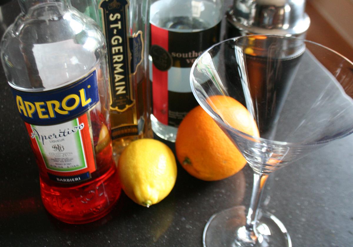 Mr. 404 Cocktail ingredients - Aperol, St. Germain, Vodka and fresh lemon juice.
